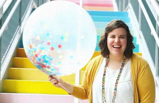 woman holding a balloon smiling