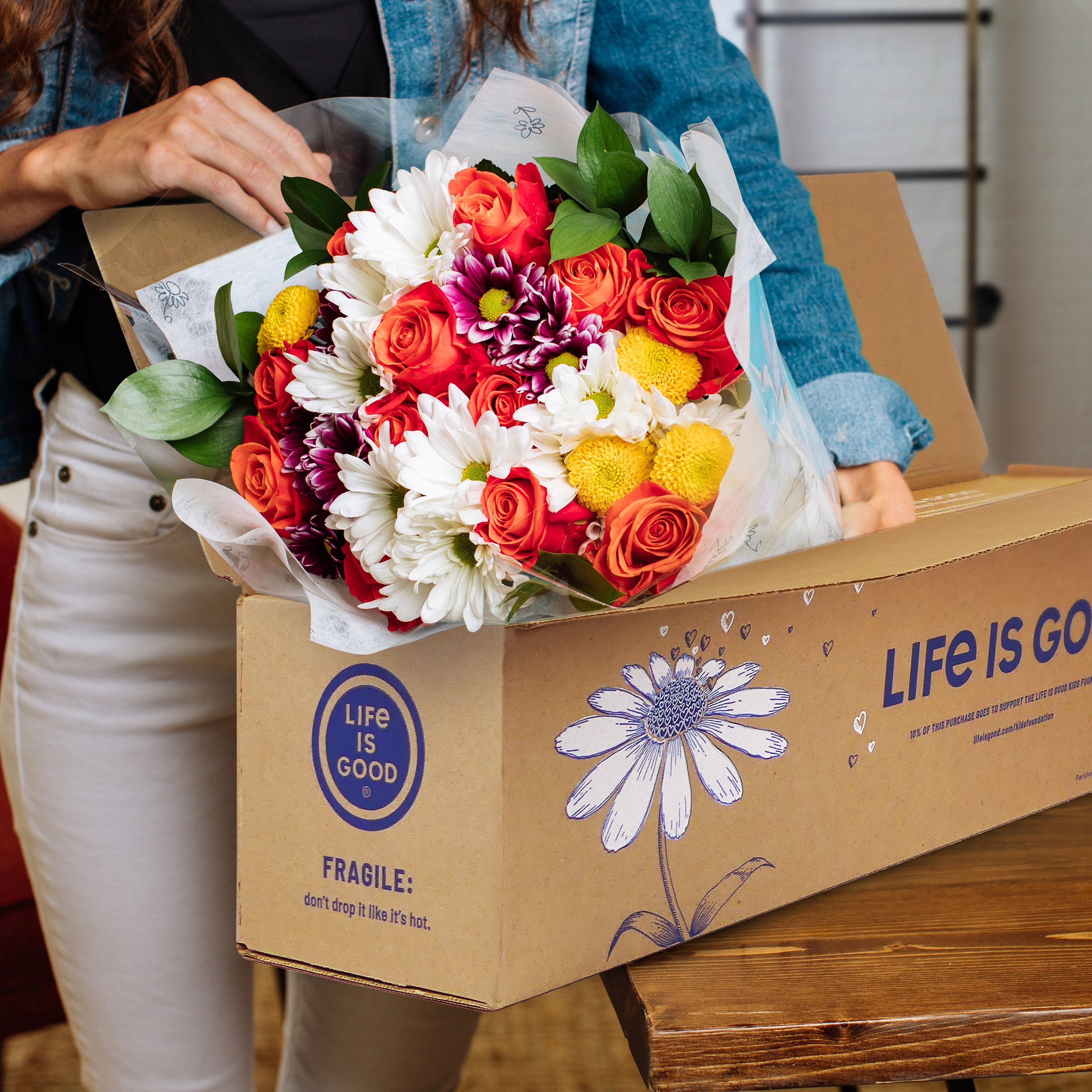 a woman with life is good flowers freshly shipped