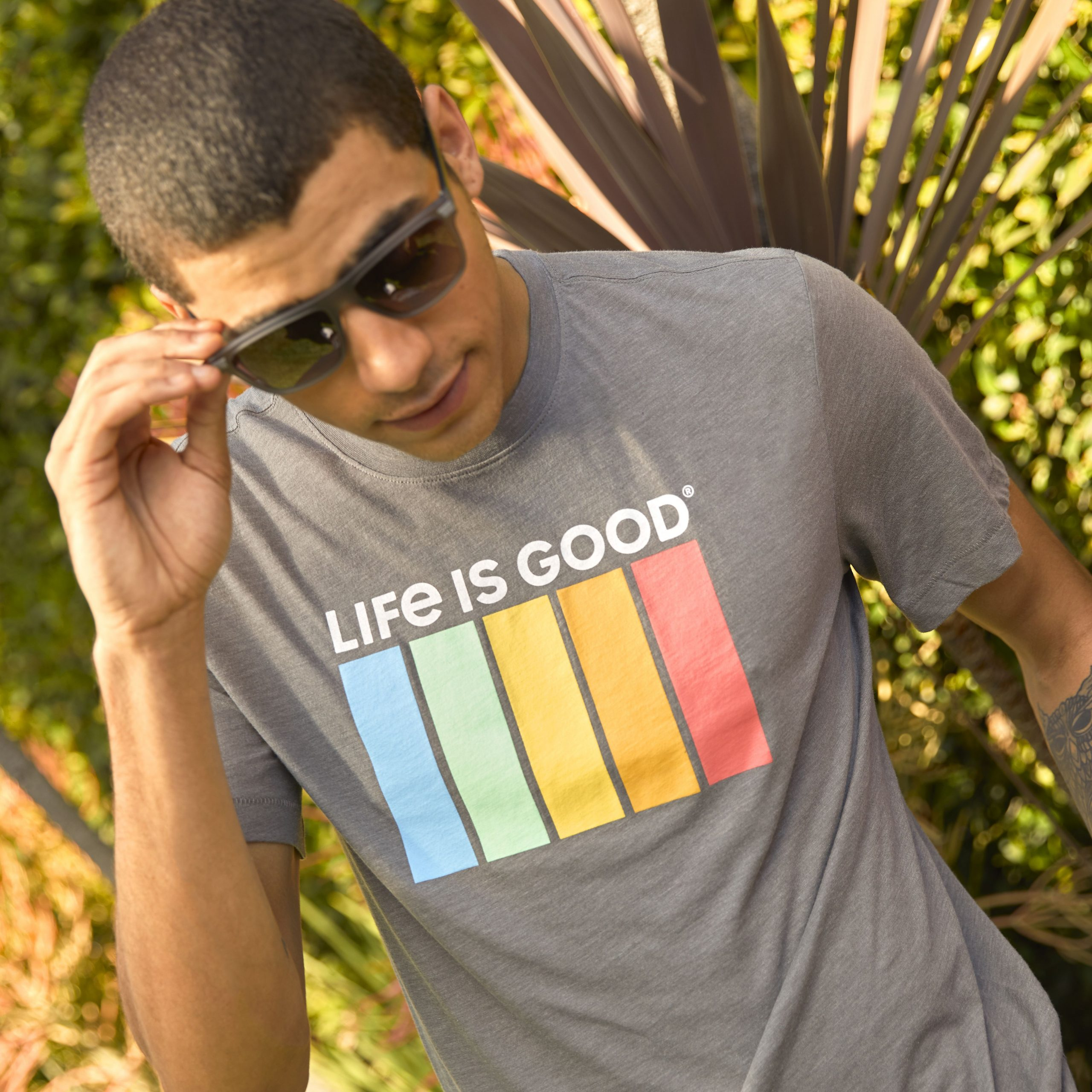 cool kid in shades wearing a Life is Good tee